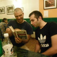 Bryan Teaching Adam About the History of India at Cafe Turtle