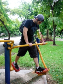 Adam Working Out on Park Workout Equipment