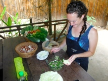 Taste testing our delicious Laap Gai (a popular Lao dish of chopped chicken and fresh Lao herbs)