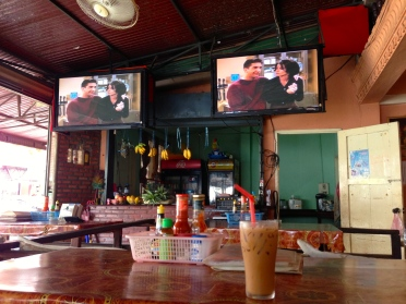 Vang Vieng is littered with roadside restaurants where you sit on pillows to eat and watch your favourite shows (no commercials)!