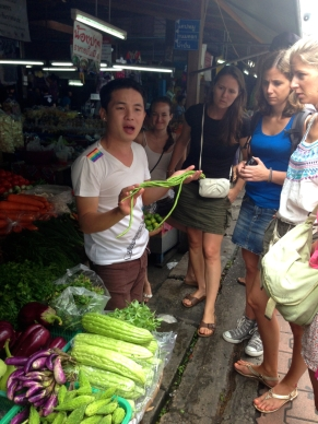 We took a quick tour of the local market to learn more about our ingredients prior to cooking. This is a photo of our master chef, 'A', teaching us about long beans.