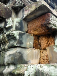 The orange-coloured porous stone is the strong foundation of the temple. Sandstone was used to cover the latterite so that the surface could be made into elaborate carvings.