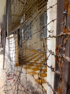 Since the buildings at Tuol Sleng where 3 storeys high, this barbed wire netting was used to prevent prisoners from jumping off the balconies to commit suicide.
