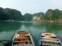 Rowing Through the Fishing Village in Ha Long Bay