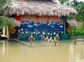 On our way home from Ha Long Bay, we stopped at a farm to watch a traditional Vietnamese water puppet show... it was quite entertaining! I guess the puppets are controlled under the surface of the water with the puppeteers standing behind the stage curtain.